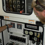 photo of inside of vessel Hercules showing crew maintaining controls