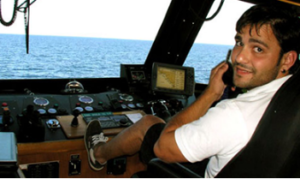 photo of Edwin Vella at ship's controls
